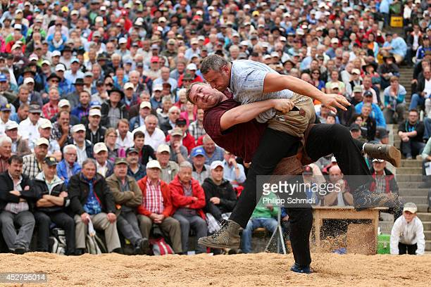 Swiss Alpine wrestler Christian Stucki fights with Arnold Forrer during the Alpine Wrestling Festival BruenigSchwinget at the top of the Bruenig Pass...