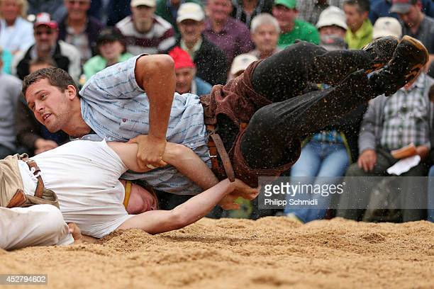 Swiss Alpine wrestler Marcel Mathis fights with Philipp Gehrig during the Alpine Wrestling Festival BruenigSchwinget at the top of the Bruenig Pass...