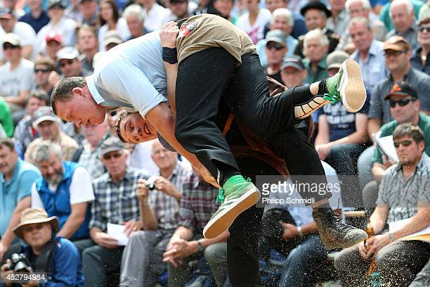 Swiss Alpine wrestler Matthias Sempach climbs on top of Joel Wicki during the Alpine Wrestling Festival BruenigSchwinget at the top of the Bruenig...