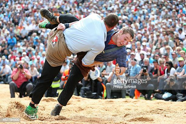 Swiss Alpine wrestler Matthias Sempach fights with Joel Wicki during the Alpine Wrestling Festival BruenigSchwinget at the top of the Bruenig Pass on...