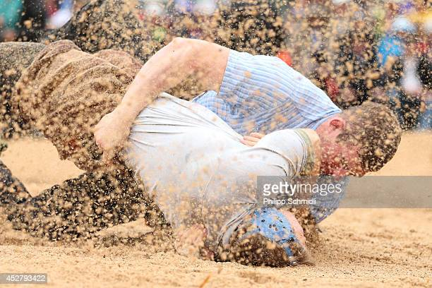 Swiss Alpine wrestler Philipp Laimbacher fights with Bernhard Kaempf during the Alpine Wrestling Festival BruenigSchwinget at the top of the Bruenig...