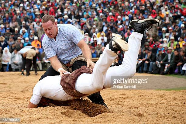 Swiss Alpine wrestler Simon Anderegg fights on top of Gerry Sueess during the Alpine Wrestling Festival BruenigSchwinget at the top of the Bruenig...