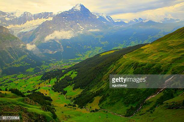 Swiss Alps: Eiger massif, river cascade above Grindelwald, dramatic evening