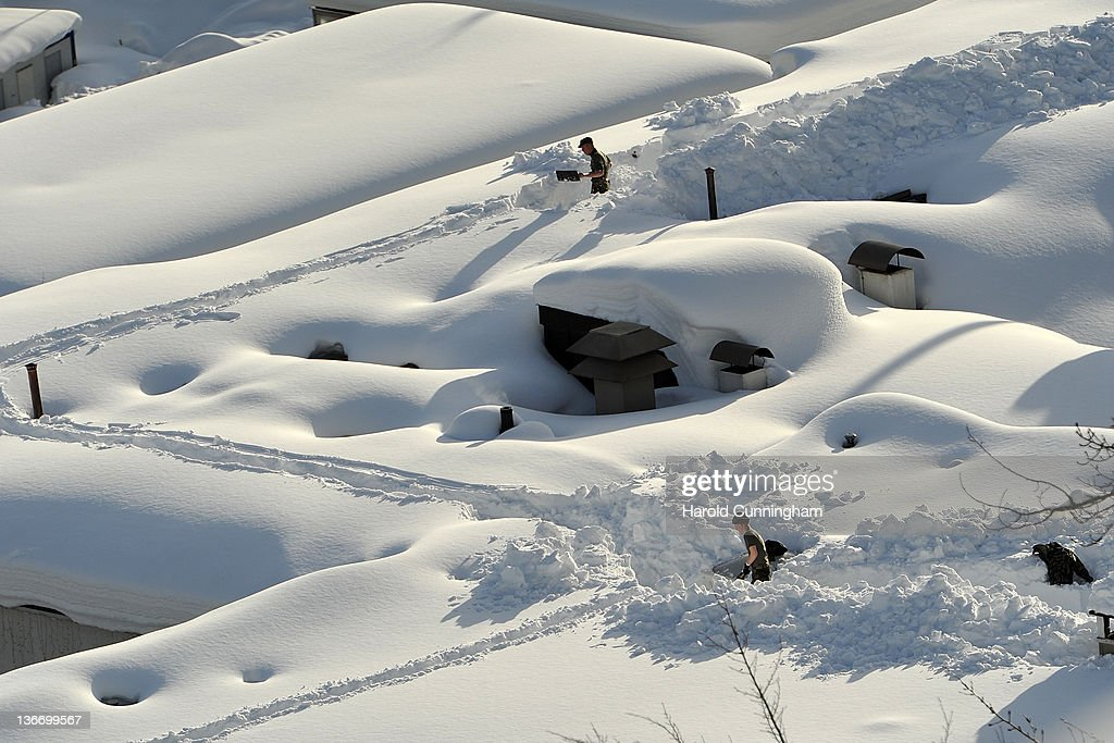 Swiss army soldiers dig snow trenches on a roof on January 10, 2012 in Davos, Switzerland. The World Economic Forum, which gathers the World's top leaders, runs from January 25 - 29.