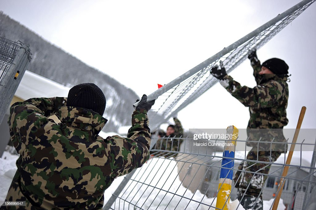 Swiss army soldiers install fences on January 10, 2012 in Davos, Switzerland. The World Economic Forum, which gathers the World's top leaders, runs from January 25 - 29.