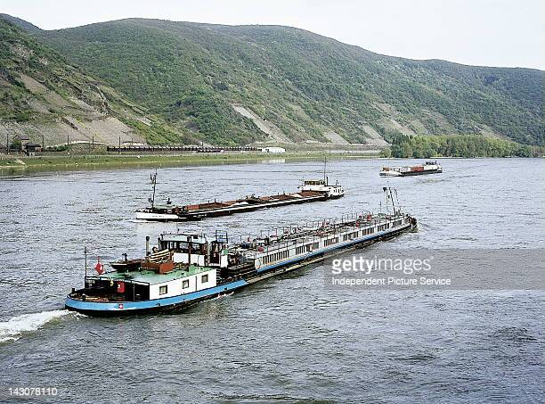 A Swiss barge and other barges on the Rhine River near Eschenz Switzerland