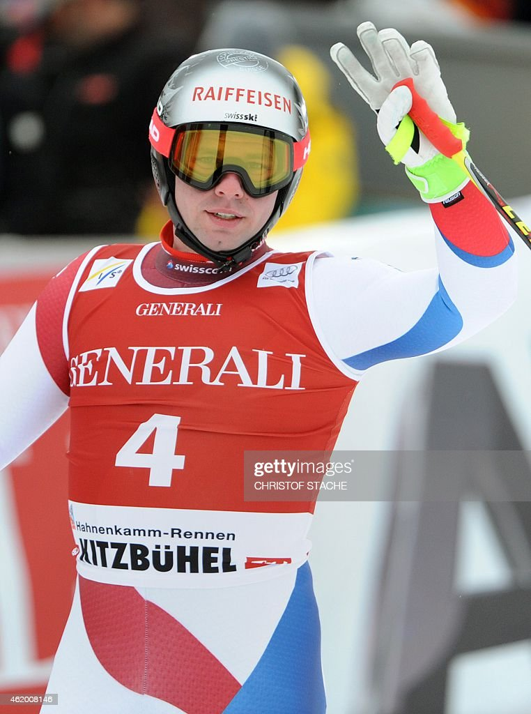 Swiss <a gi-track='captionPersonalityLinkClicked' href=/galleries/search?phrase=Beat+Feuz&family=editorial&specificpeople=4193254 ng-click='$event.stopPropagation()'>Beat Feuz</a> reacts in the finish area after the men's downhill Super G race of the FIS Alpine Skiing World Cup in Kitzbuehel, Austria, on January 23, 2015. Italy's Dominik Paris won ahead of the second Matthias Mayer of Austria and third placed Georg Streitberger of Austria. AFP PHOTO / CHRISTOF STACHE