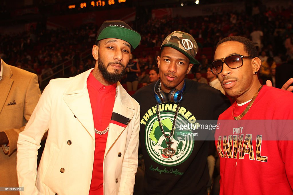 Swiss Beats, Nick Cannon and Ludacris pose for a photo during the 2013 NBA All-Star Game during All Star Weekend on February 17, 2013 at the Toyota Center in Houston, Texas.