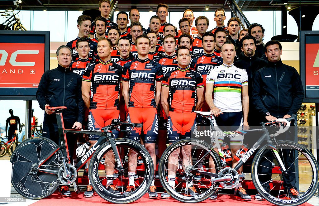 Swiss BMC Racing team's members (LtoR, 1st row, other unidentified) US General Manager James Jim L. Ochowicz, Norwegian Thor Hushovd, American Tejay Van Garderen, Australian Cadel Evans, Belgian Philippe Gilbert and Belgian Team Manager John Lelangue, pose for the photographer during the cycling team presentation, ahead of the new cycling season, on January 11, 2013 in Nazareth. BELGA PHOTO ERIC LALMAND