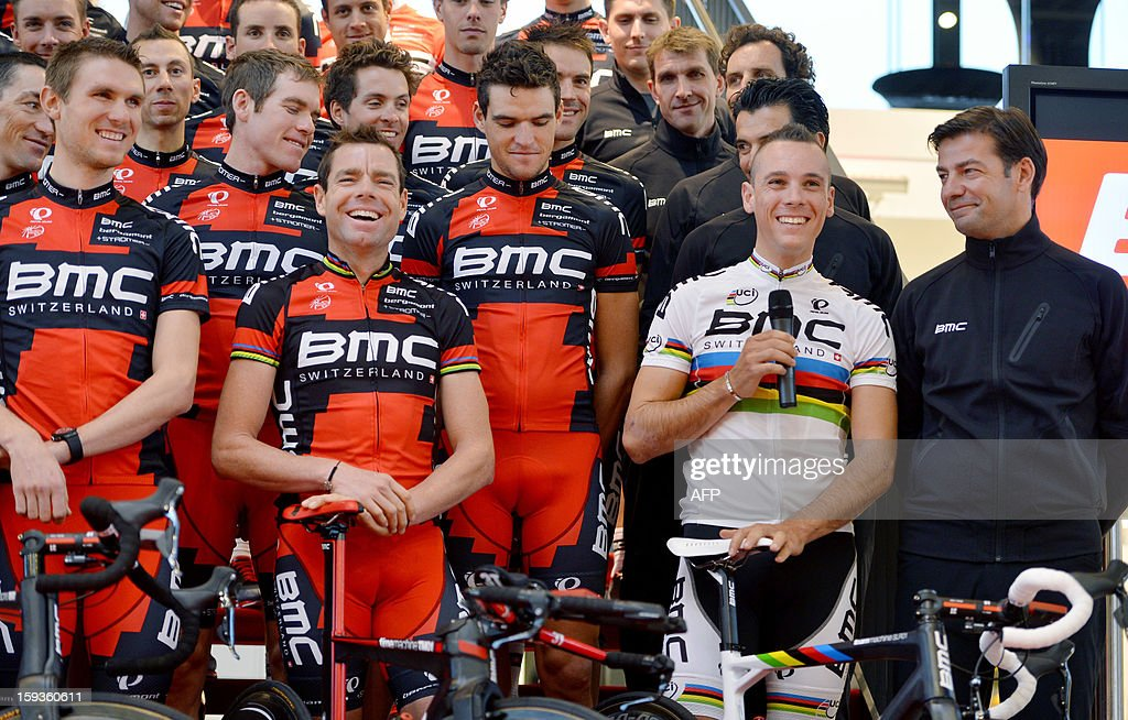 Swiss BMC Racing team's members, US Tejay Van Garderen, Australian Cadel Evans listen to teammate Belgian Philippe Gilbert who speaks during the presentation of BMC racing team, ahead of the new cycling season, on January 11, 2013 in Nazareth. At right, 1st row, Belgian Team Manager John Lelangue.