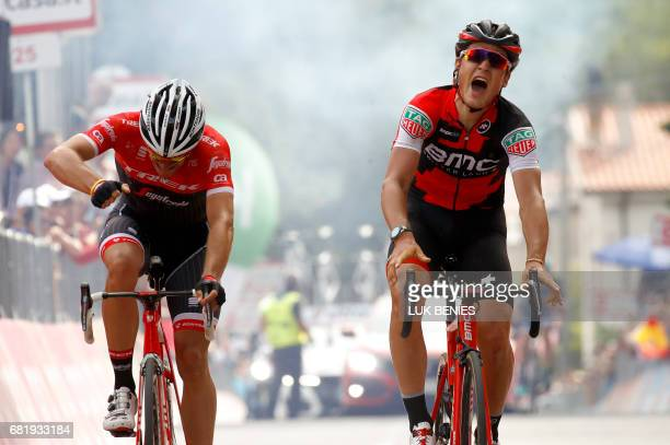 Swiss BMC rider Silvan Dillier celebrates as he crosses the finish line ahead Belgian rival Jasper Stuyven of team Trek to win the 6th stage of the...