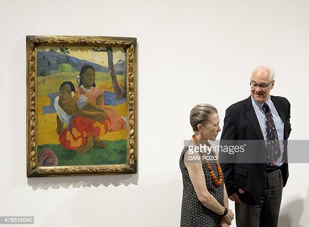 Swiss businessman and art collector Rudolf Staechelin and his wife chat past Paul Gauguin's 'Nafea Ipoipo faa' the most expensive painting ever sold...
