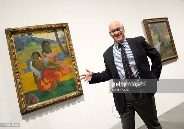 Swiss businessman and art collector Rudolf Staechelin poses past Paul Gauguin's 'Nafea Ipoipo faa' the most expensive painting ever sold at the Reina...