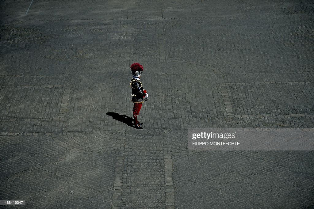 A swiss Captain stands in San Damaso square at the Vatican during new Swiss Guards recruit swearing-in ceremony in on May 6, 2014. 35 new recruits sworn-in on the anniversary of the sack of Rome when they protected Pope Clement VII hideout at castel Sant' Angelo on May 6, 1527. AFP PHOTO/ Filippo MONTEFORTE