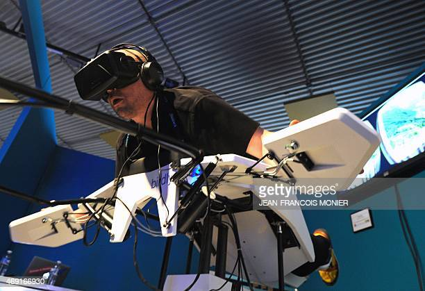 Swiss CEO of Somniacs Inc Michel Zai demonstrates his company's device 'Birdly' a flight simulating installation which explores the experience of a...