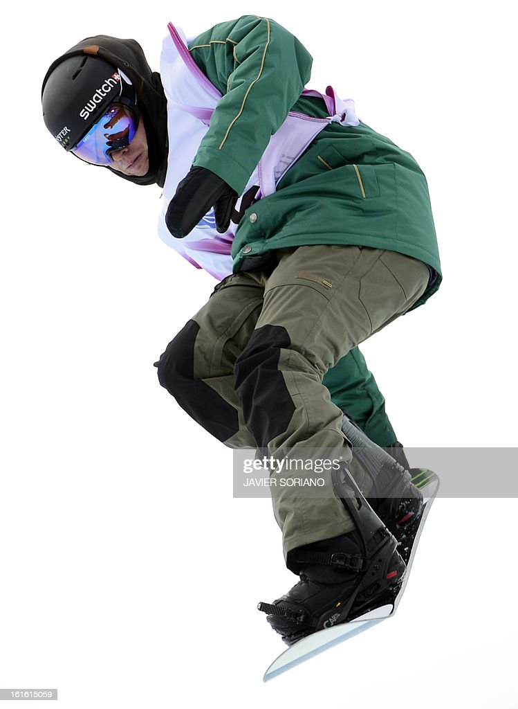Swiss Christian Haller competes in a Half-Pipe qualifaying race during the Snowboarding World Cup Test Event at Snowboard and Free Style Center in Rosa Khutor near Sochi on February 13, 2013.