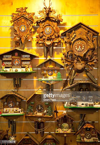 Swiss clocks on wall for sale.