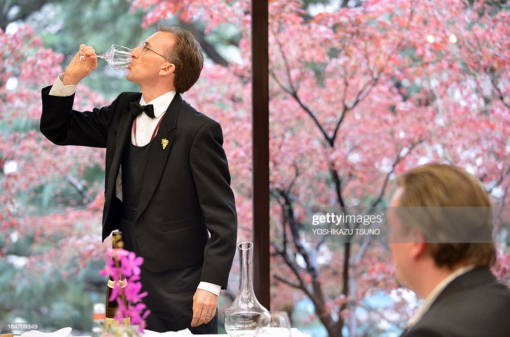 Swiss contestant Paolo Basso tastes wine before judges during the quarter-final of the 14th world sommelier contest in Tokyo on March 27, 2013. Wine waiters of the world gathered in Tokyo on March 27 for a competition to find the planet's best sommelier. AFP PHOTO / Yoshikazu TSUNO