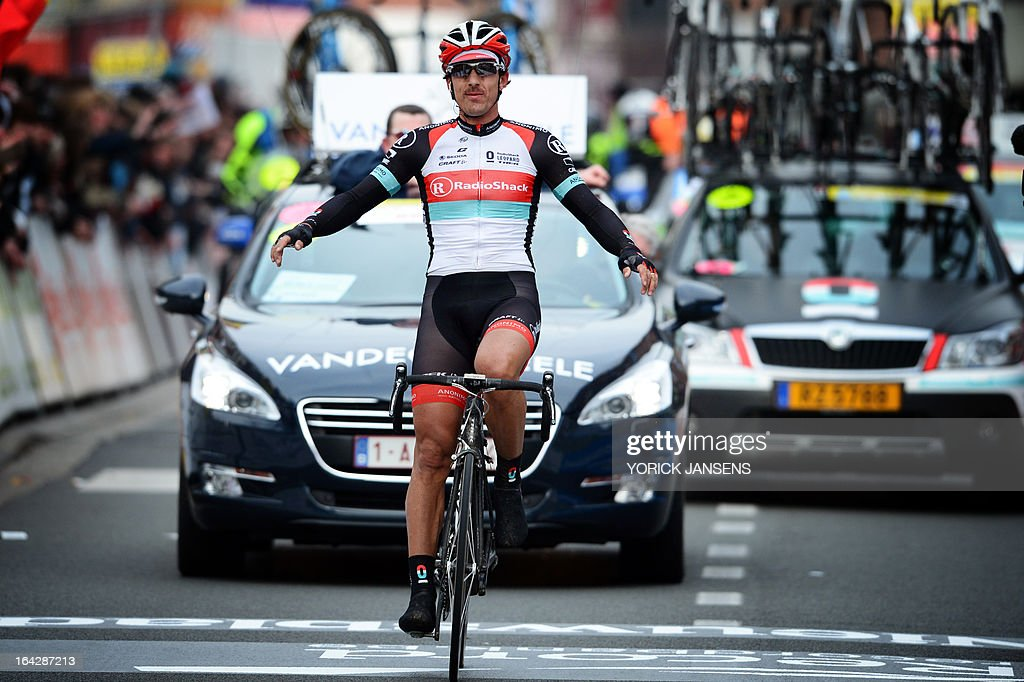 Swiss cyclist Fabian Cancellara of team RadioShack-Leopard celebrates as he crosses the finish line to win the 56th edition of cycling race E3 Prijs Vlaanderen Harelbeke, a 203km race from Harelbeke to Harelbeke, on March 22, 2013. JANSENS -Belgium Out-