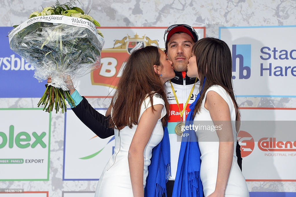 Swiss cyclist Fabian Cancellara of team RadioShack-Leopard is kissed by two women on the podium after winning the 56th edition of cycling race E3 Prijs Vlaanderen Harelbeke, a 203km race from Harelbeke to Harelbeke, on March 22, 2013. LALMAND -Belgium Out-