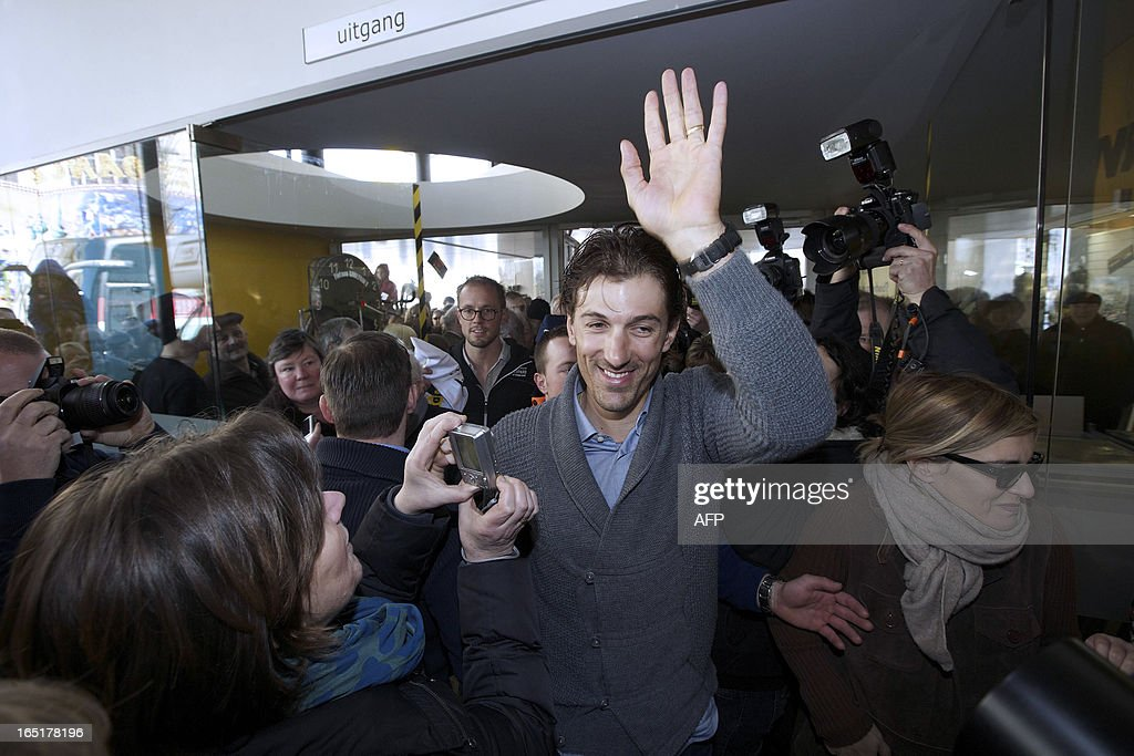 Swiss cyclist Fabian Cancellara of team RadioShack-Leopard (C) waves to the crowd during a visit to supporters in a bar in Oudenaarde, on April 1, 2013. Cancellara won the one-day classic Tour of Flanders for the second time on March 31, 2013. AFP PHOTO/BELGA/NICOLAS MAETERLINCK -Belgium Out-
