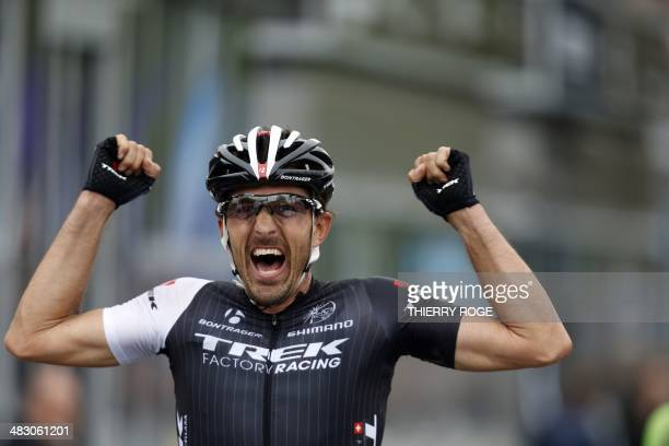 Swiss cyclist Fabian Cancellara of Trek Factory Racing celebrates as he crosses the finish line to win the Tour of Flanders oneday cycling race 259...
