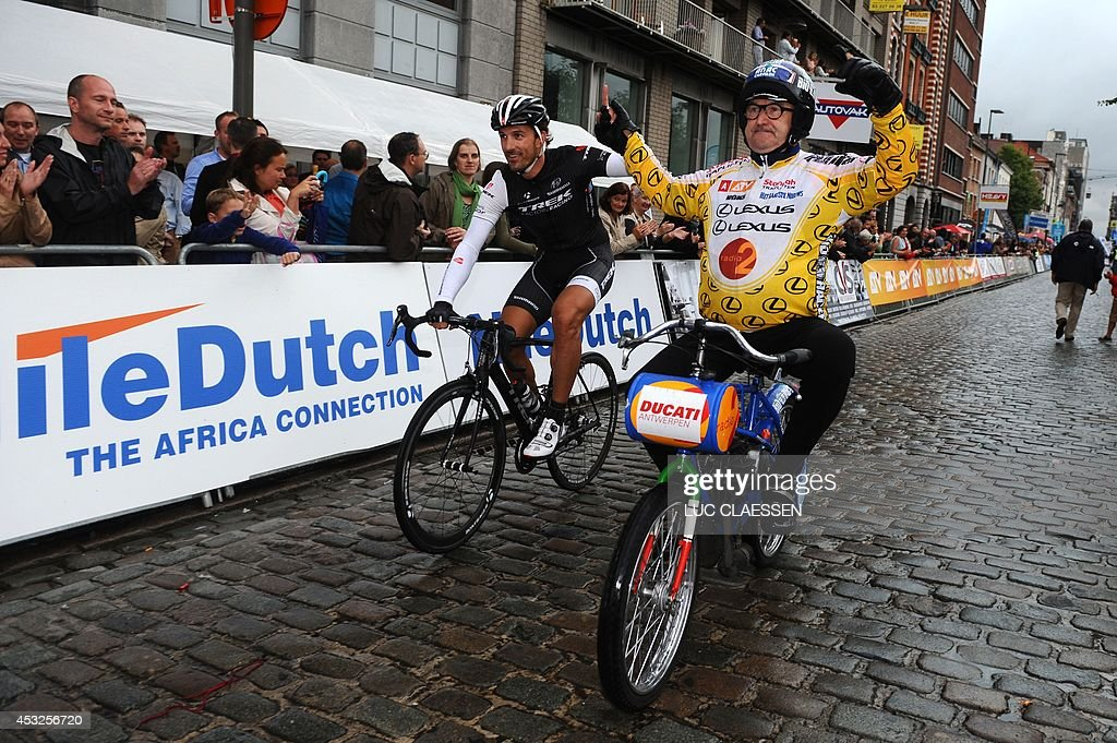 Swiss cyclist Fabian Cancellara of Trek Factory Racing (L) celebrates with Belgian Derny-rider Walter Huybrechts on August 6, 2014 after winning the 16th edition of the Antwerp Na-Tour criterium cycling race, in Antwerp. AFP PHOTO / BELGA / LUC CLAESSEN ** Belgium Out **