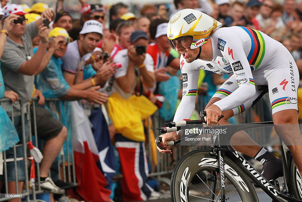 Swiss cyclist <a gi-track='captionPersonalityLinkClicked' href=/galleries/search?phrase=Fabian+Cancellara&family=editorial&specificpeople=573515 ng-click='$event.stopPropagation()'>Fabian Cancellara</a> races through an 8.9 time trial course during the prolouge for the 97th Tour de France on July 3, 2010 in Rotterdam, Netherlands. Cancellara won the event with a winning of 10min 00sec to take the race lead of the Tour. Following the prologue, the iconic race will include 20 stages and will cover 3,642km.