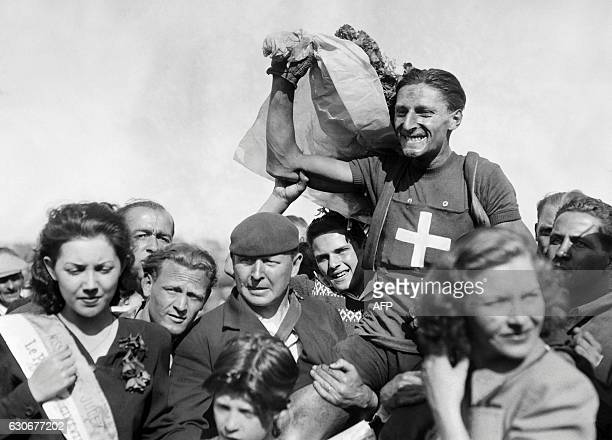 Swiss cyclist Ferdinand 'Ferdi' Kubler jubilates after winning the first stage of the Tour de France on June 26 1947 in Lille Swiss rider Ferdinand...