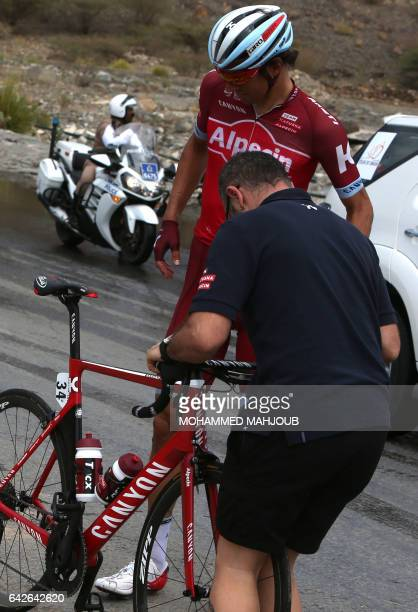 Swiss cyclist Reto Hollenstein is helped to restart after the peloton crashed during the 5th stage of the 8th edition of the cycling Tour of Oman...