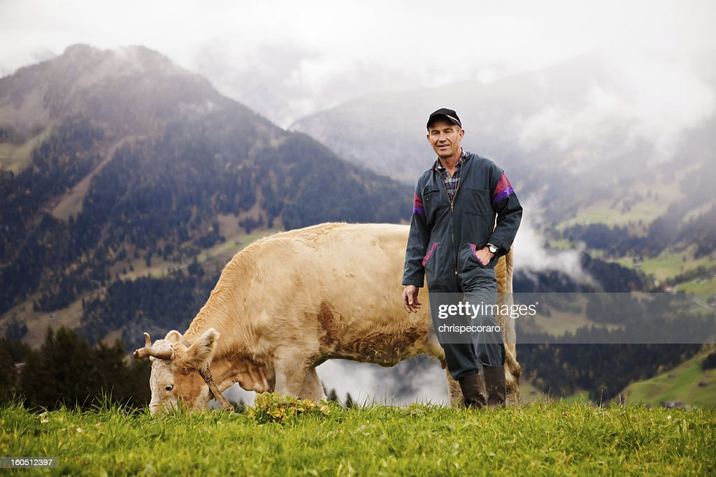 Swiss Dairy Farmer and His Prize Cow