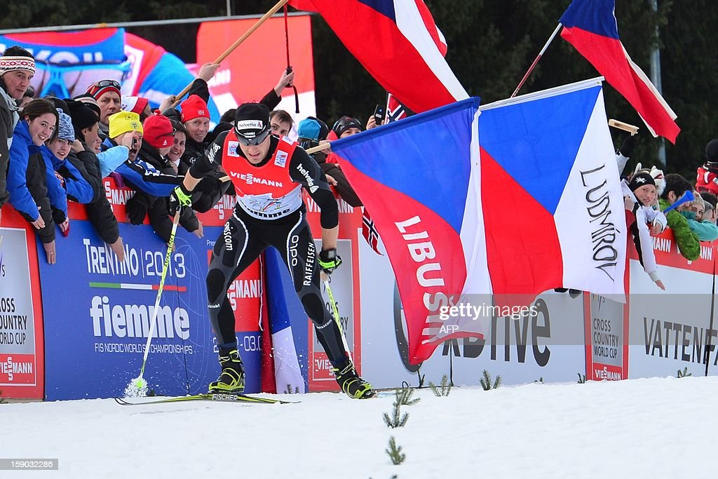 Swiss Dario Cologna of Swiss crosses the finish line during the men's nine km free final climb pursuit start race nine of the Tour de Ski in Val di Fiemme on January 6, 2013. Alexander Legkov of Russia won the race ahead of Cologna and Maxim Vylegzhnin of Russia .