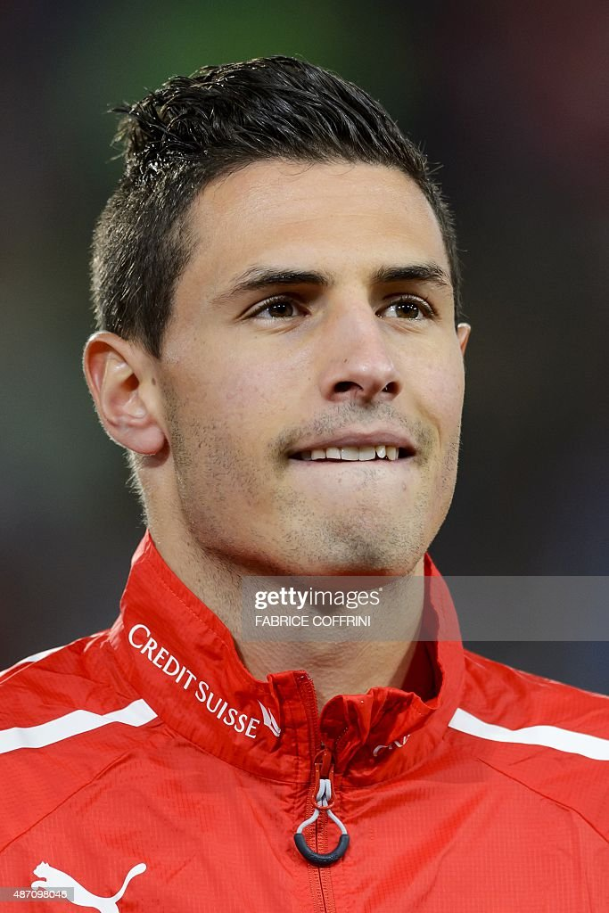 Swiss defender Fabian Schaer stands during the national anthem prior to the Euro 2016 qualifying football match between Switzerland and Slovenia at the St. Jakob Park Stadium in Basel on September 5, 2015. Switzerland defeated Slovenia 3-2.