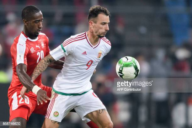 Swiss defender Johan Djourou and Hungarian forward Roland Ugrai vie for the ball during the FIFA World Cup WC 2018 football qualifier match between...