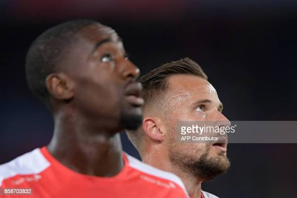 Swiss defender Johan Djourou and teammate foward Haris Seferovic look on during a warm up sesison prior to the the FIFA World Cup WC 2018 football...