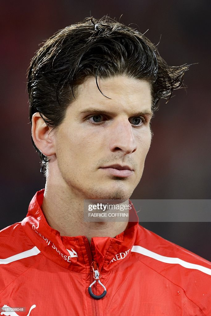 Swiss defender Timm Klose stands during the national anthem prior to the Euro 2016 qualifying football match between Switzerland and Slovenia at the St. Jakob Park Stadium in Basel on September 5, 2015. Switzerland defeated Slovenia 3-2.