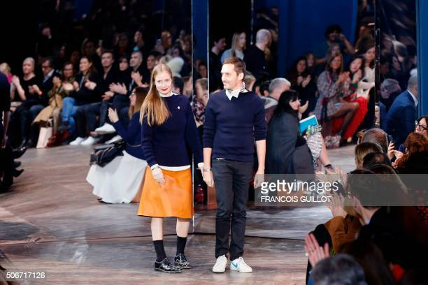 Swiss designers Serge Ruffieux and Lucie Meier acknowledge the audience after the Christian Dior show during the 20162017 spring/summer Haute Couture...