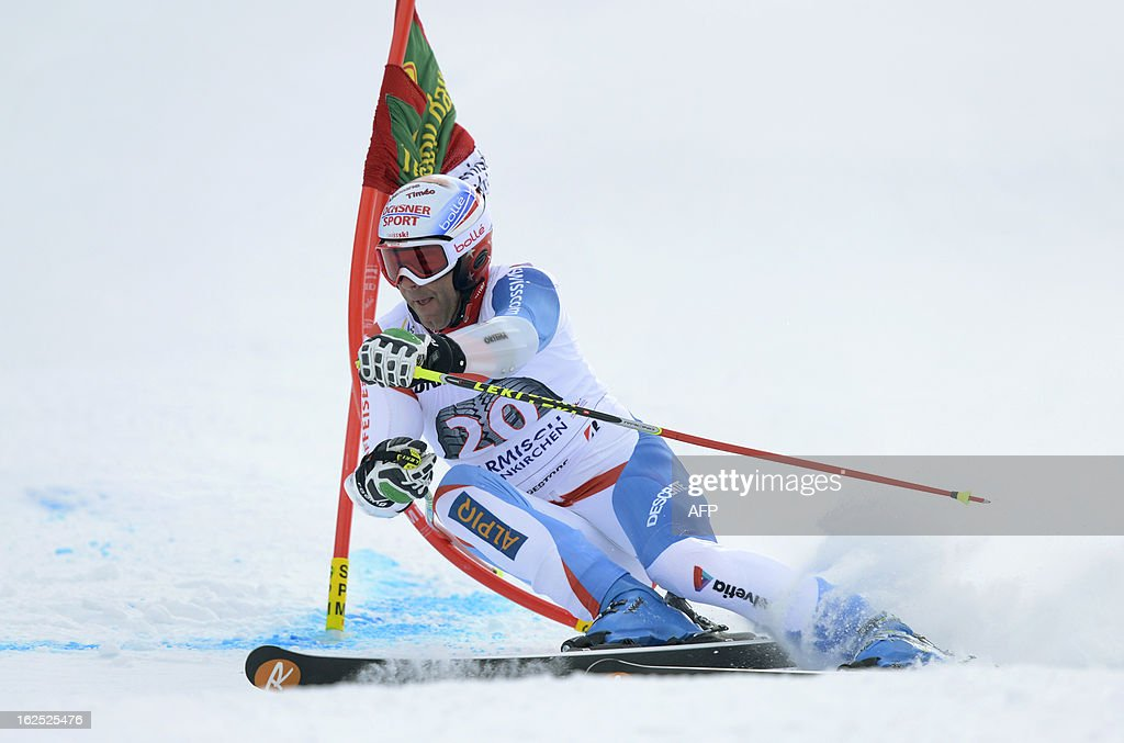 Swiss Didier Defago competes during the FIS World Cup men's Giant Slalom first run competition in Garmisch-Partenkirchen, southern Germany, on February 24, 2013. French Alexis Pinturault won the competition, Austrian Marcel Hirscher placed second and US Ted Ligety placed third.