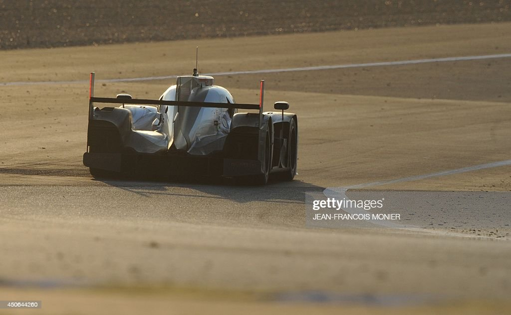 Swiss driver Marcel Fassler in his Audi R18 E-Tron Quattro Hybrid N°2 competes during the 82nd Le Mans 24 hours endurance race, on June 15, 2014 in Le Mans, western France. Fifty-six cars with 168 drivers are participating on June 14 and 15 in the Le Mans 24-hours endurance race.