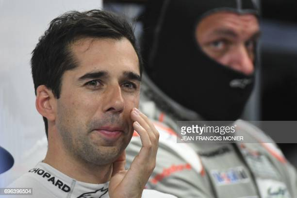 Swiss' driver Neel Jani attends in his pit during the fourth the qualifying practice session of the Le Mans 24 hours endurance race on June 15 2017...