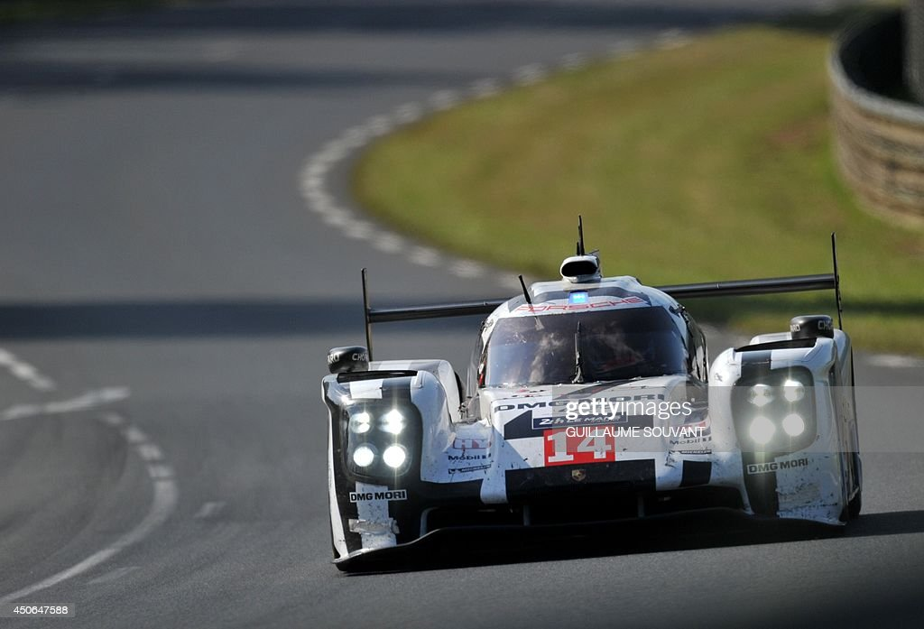Swiss driver Neel Jani in his Porsche 919 Hybrid N° 14 competes during the 82nd Le Mans 24 hours endurance race, on June 15, 2014 in Le Mans, western France. Fifty-six cars with 168 drivers are participating on June 14 and 15 in the Le Mans 24-hours endurance race.