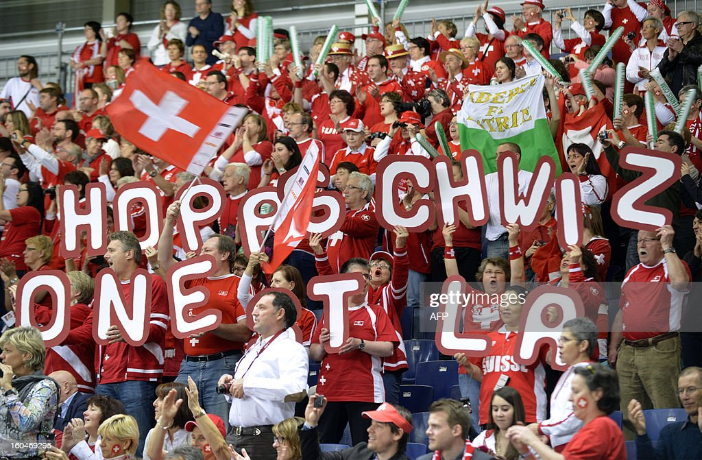 Swiss fans cheer on February 1, 2013 during the Davis Cup World Group first round game between Switzerland and the Czech Republic in Geneva.