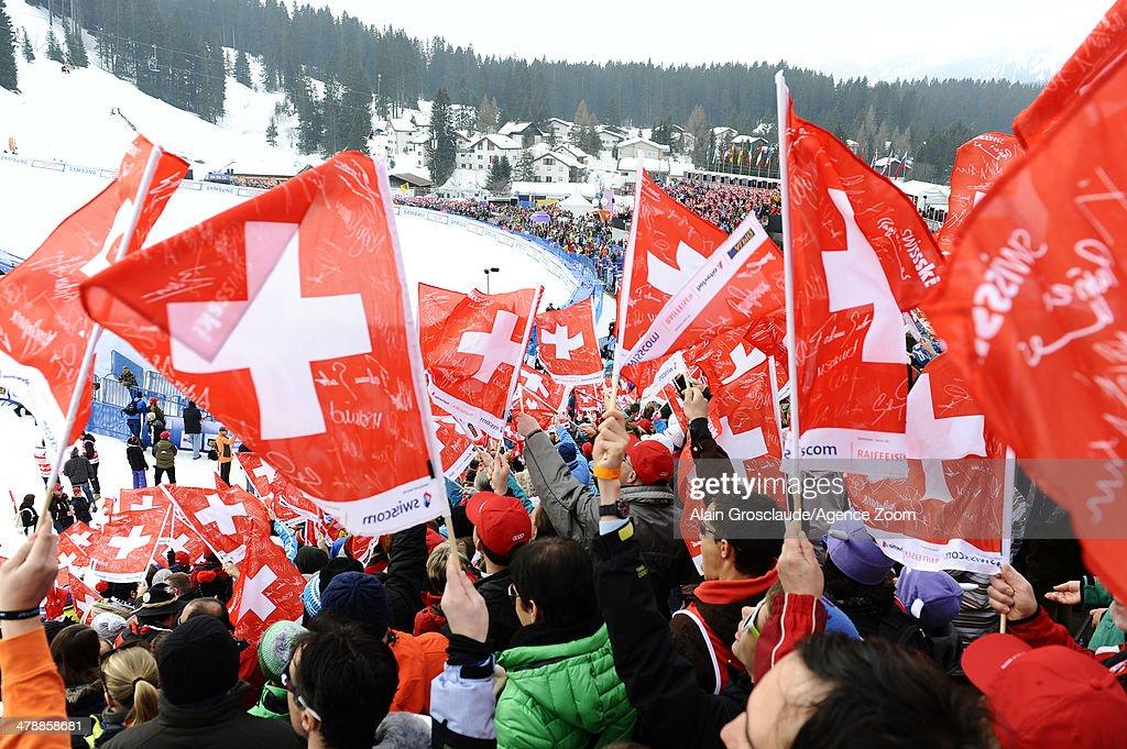 Swiss fans enjoy the action during the Audi FIS Alpine Ski World Cup Finals on March 15, 2014 in Lenzerheide, Switzerland.