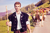 Swiss farmer leading decorated cows to Aelplerfest