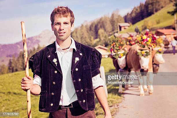Swiss farmer leading decorated cows to Aelplerfest