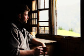 Swiss farmer staring out of window