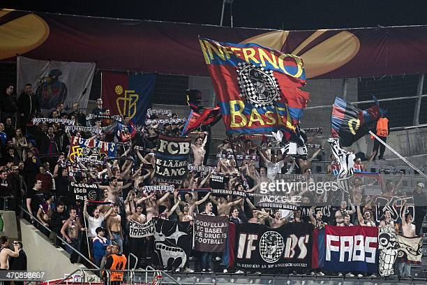 Swiss FC Basels fans cheer no their team during the UEFA Europa League round of 32 qualifying football match Maccabi Tel Aviv FC vs and FC Basel at...