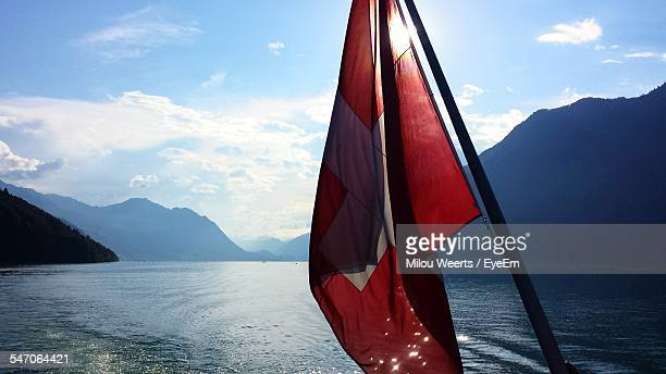 Swiss Flag By Water