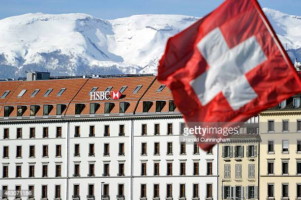 Swiss flag flies above a HSBC logo is seen on HSBC offices on February 9 2015 in Geneva Switzerland It has been discovered that the HSBC bank has...
