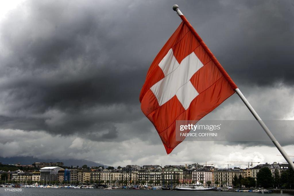 A Swiss flag flies on the shores of Geneva Lake on June 14, 2013 in the center of Geneva.